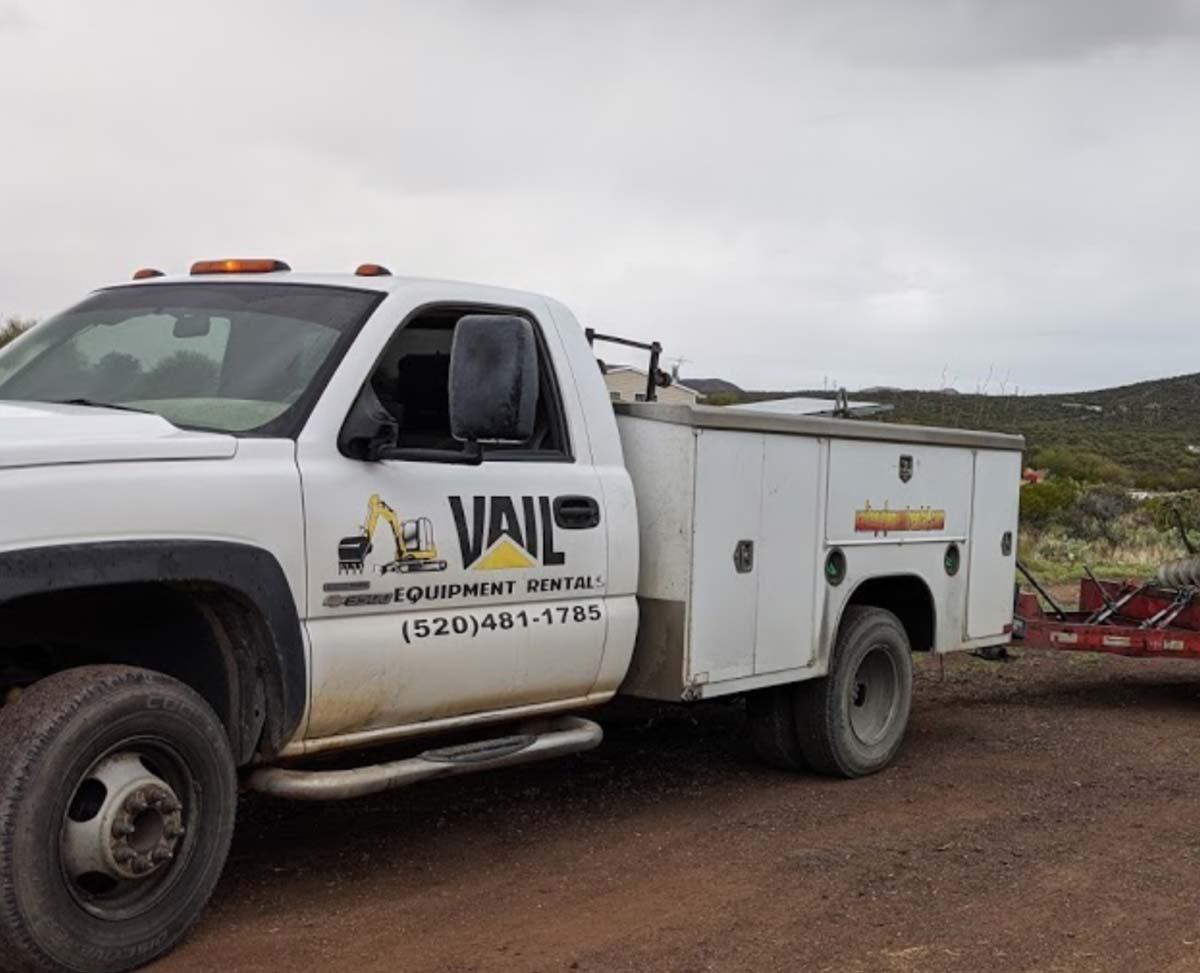 white truck with vail equipment rentals logo